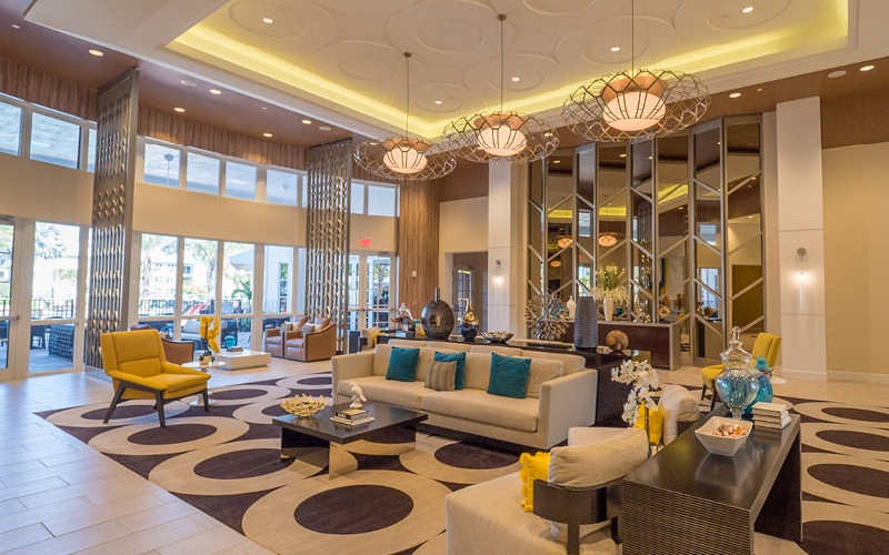 luxurious, clubhouse displays beautiful ceiling with light soffits and hanging light fixtures