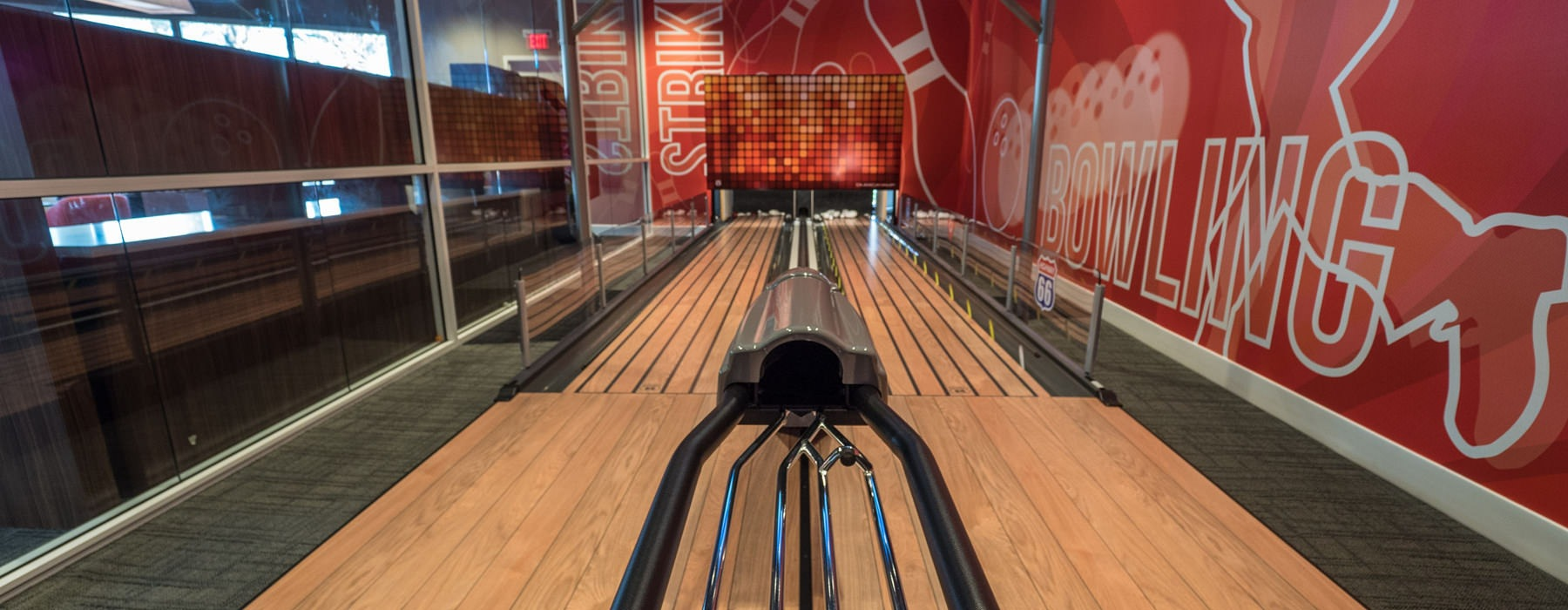 indoor bowling alley in well lit room